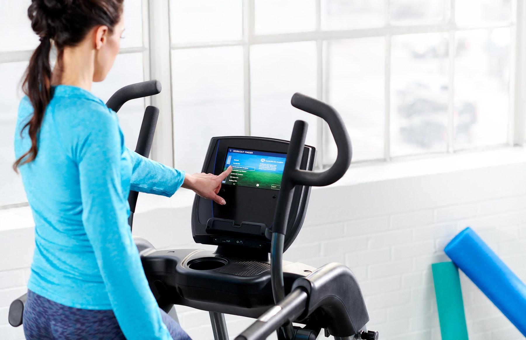 Why Buy TRUE? Woman on TRUE Treadmill.