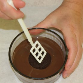 transfer sheet placing cookie in chocolate