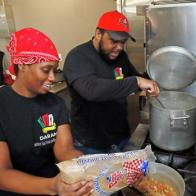 Darrell and Celena Randle work as a team under the name Daran's Southern Soul Food and West Indian Cuisine and prepare their meals at the Square One kitchen in Fargo. David Samson / The Forum