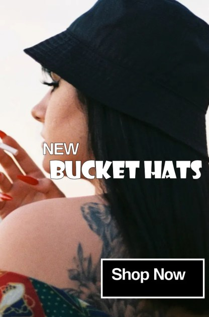Woman smoking with tattoo on shoulder wearing black bucket hat