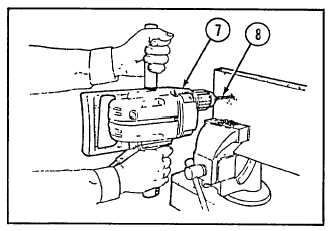 USING THE PORTABLE ELECTRIC DRILL