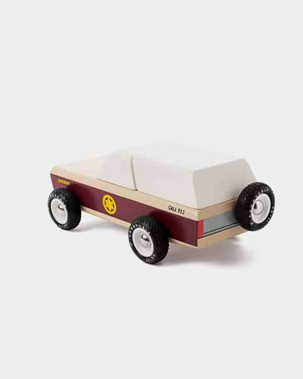 Brown and white wooden toy car