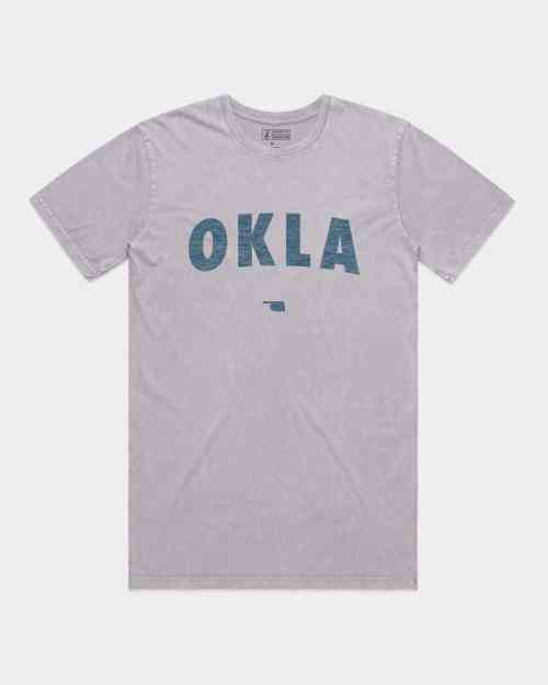 An orchid stone wash tee shirt with OKLA screen printed on the front in navy blue ink