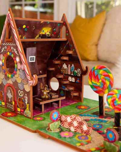 A photo of the inside of a Hansel and Gretel storybook toy