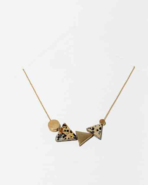 A brace necklace with klee dalmation stones on the botton