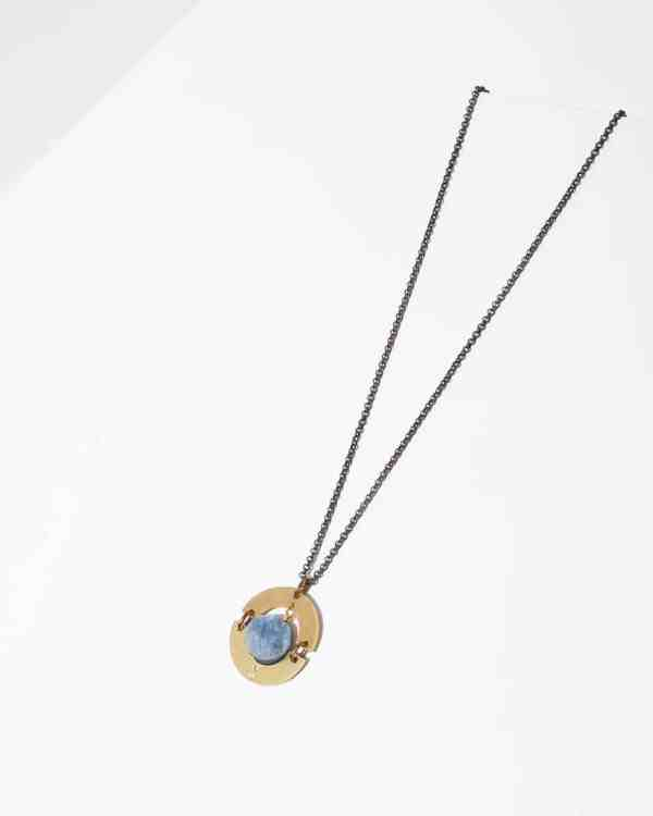 A necklace with a kyanite stone on a brass chain