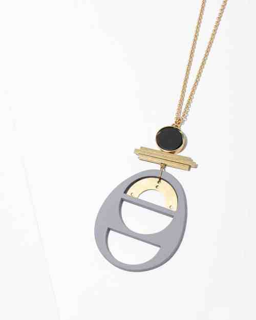 A Maquette necklace on a brass chain with an onyx stone