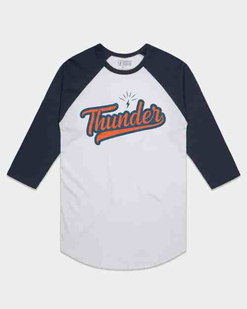 A white and blue raglan tee with Thunder written across the front in orange