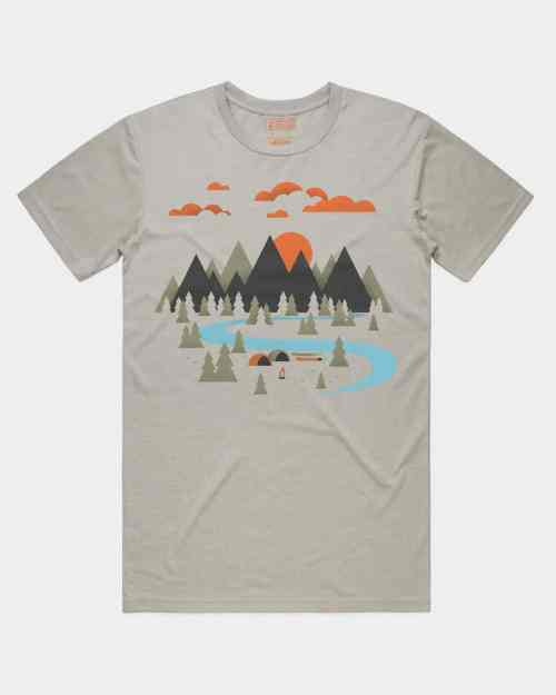 A light grey tee with a valley design on it in green, blue, orange, and black ink