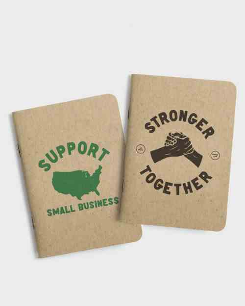 Set of 2 small kraft paper notebooks. Both with screen printed covers, the first with a support USA small business graphic, the second with stronger together graphic