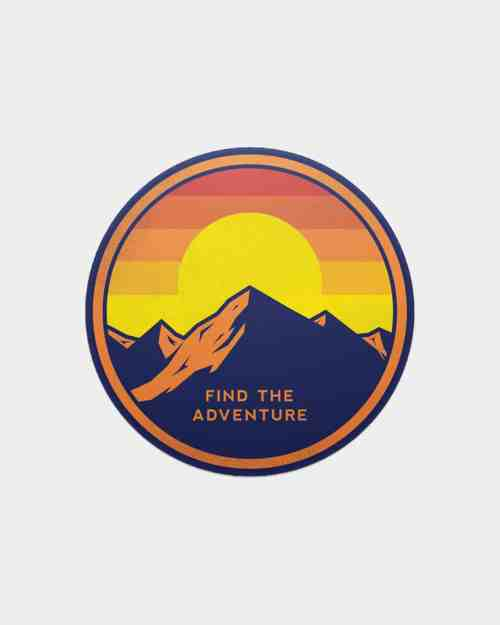 A sticker with mountains on it with the phrase Find the Adventure.