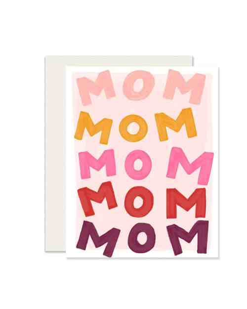 A white card with Mom Mom Mom printed on the front in pink, yellow and red.