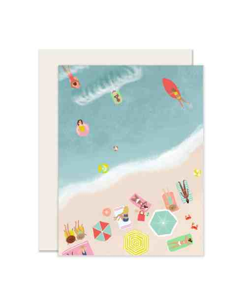 A card with a beach scene printed on the front.
