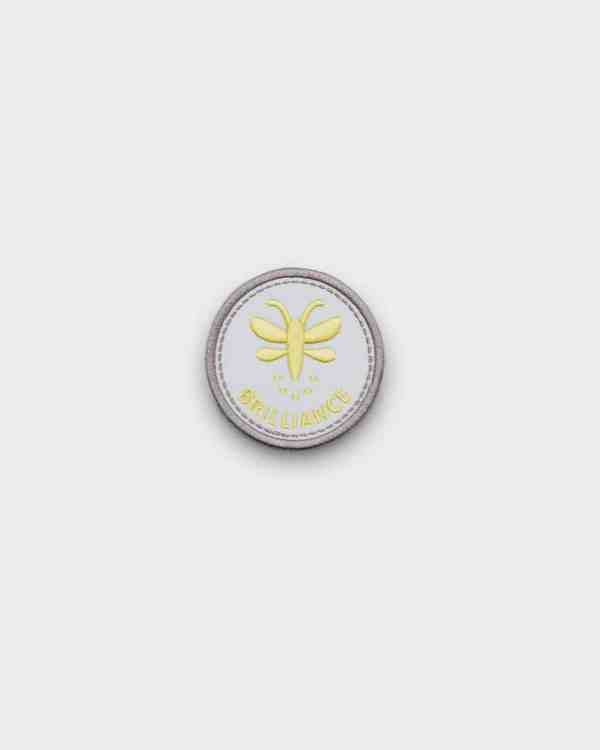 white and yellow patch that says 'brilliance'