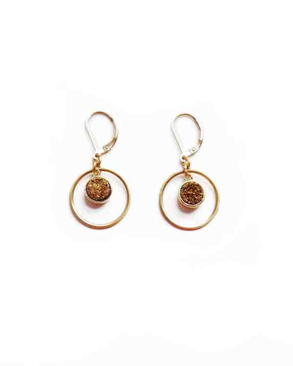 Gold earrings with gold center stones