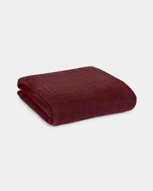 A mockup of a maroon baby swaddle