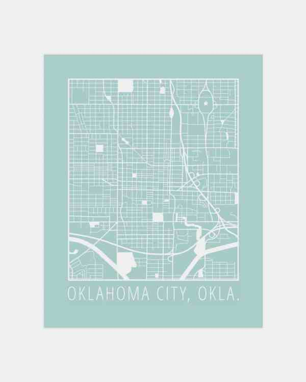 A light blue poster with a white print of the map of Oklahoma City on it