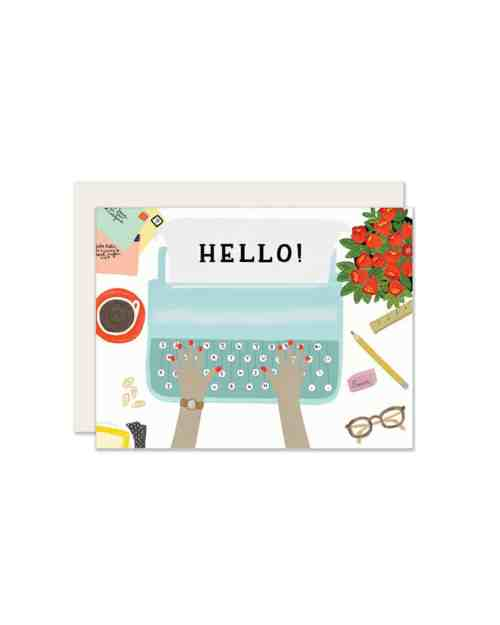 a white card with a blue typewriter on it typing out the word hello