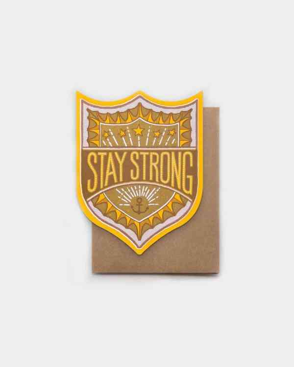 Brown and yellow card that says 'Stay Strong'