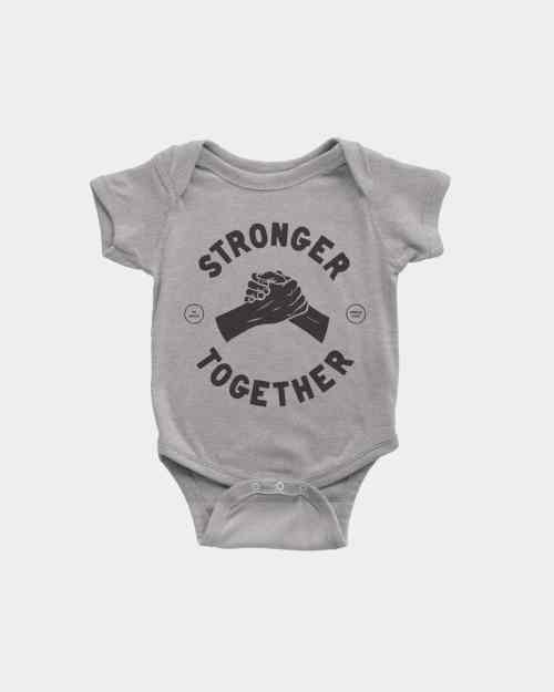 A grey kids onesie that say stronger together in black ink