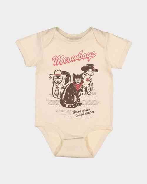 natural colored onesie with a coral and brown print of cats in cowboy attire