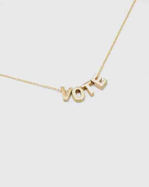 A gold chain necklace that says vote