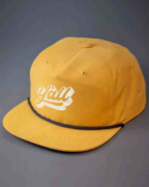 a yellow hat that says yall in a khaki print