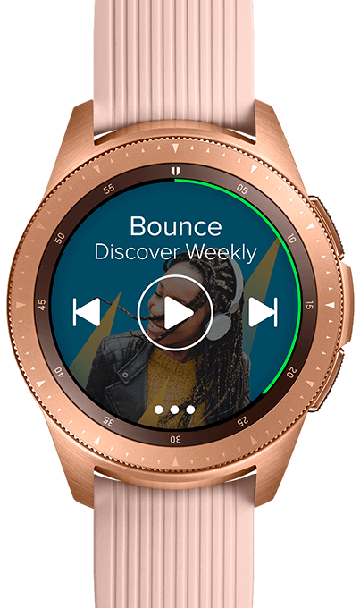 Closeup of a 42mm Rose Gold Galaxy Watch playing music with song info and play controls on the watchface.