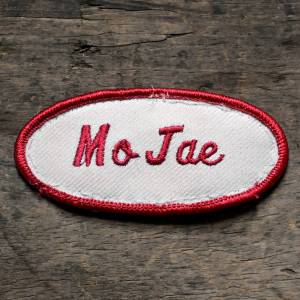 VERN  NEW EMBROIDERED  SEW IRON ON NAME PATCH BLUE ON WHITE