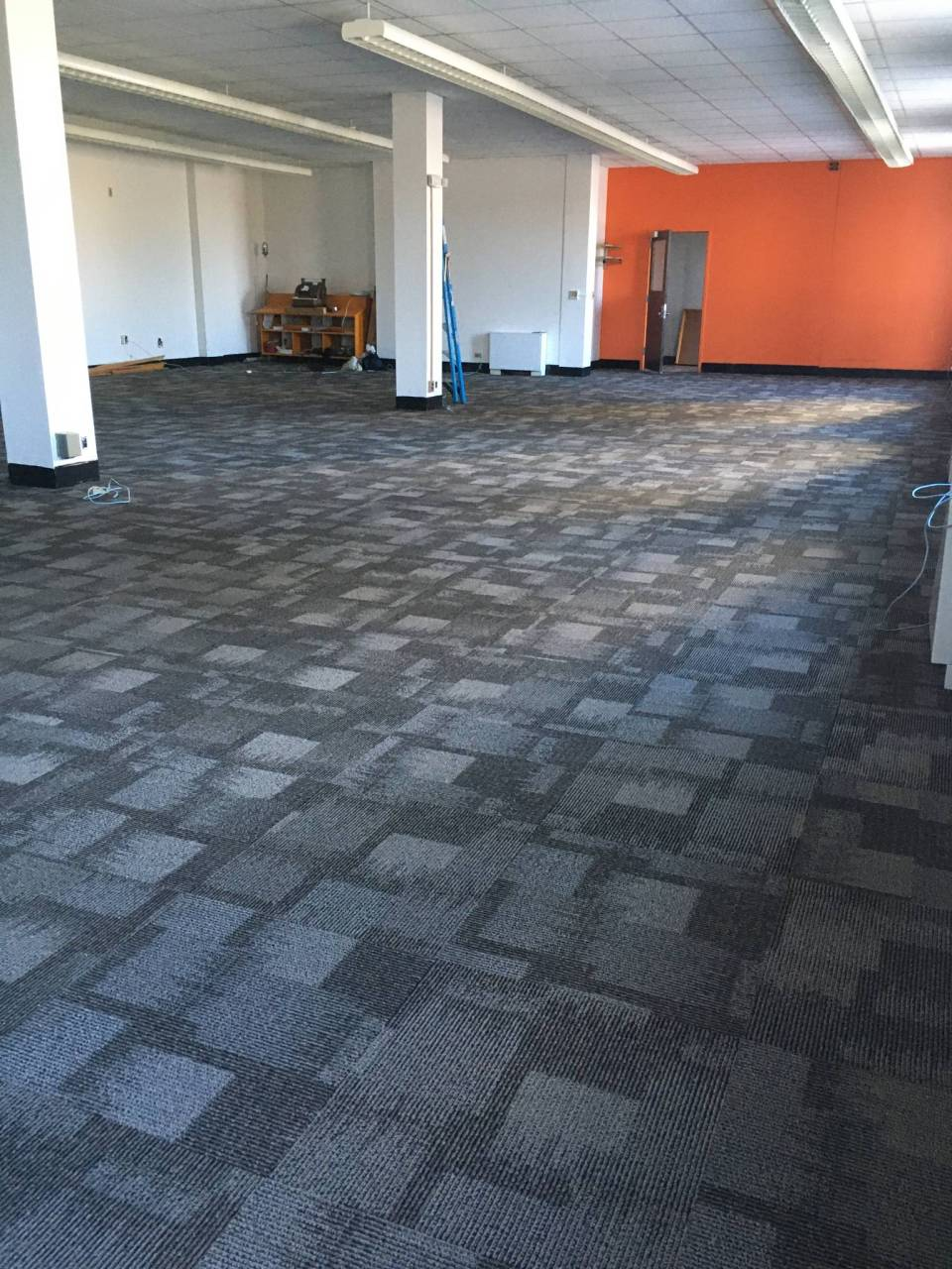 One of the greatest things about our new digs? We've connected with a building owner who shares our appreciation of reuse... he's replaced worn carpet with fresh stuff sourced via surplus/returns (and he happily used our own orange paint to give that already-orange wall a fresh coat).