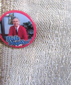 Close up of Mr Rogers Hello Neighbor button