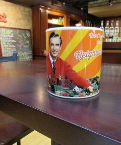 Mr Rogers neighborhood coffee mug on a table