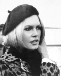 Notice how the lines of the beret and the scarf frame and focus on Brigette Bardot's face.