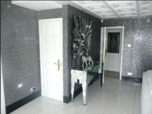 Glitter Wallpaper comes in many colors and the effect can be glam, starry, or fantasy. BigGreen.Com