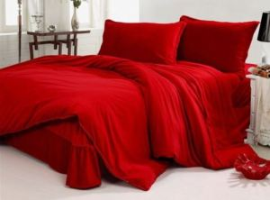 No need for a fancy bed; the simplest platform will do when you use smoking hot red bed linens. Hometone.Com