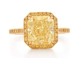Radiate Solar Flair in this engagement ring featuring a stunning square yellow diamond surrounded by lots and lots of more yellow diamonds, highlighted by the 18k yellow gold setting. Available at Kwiat.com.