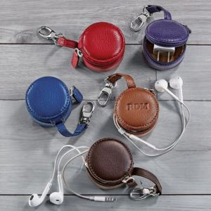 Besides fine quality paper, notes, pens, and the like, Levenger is also known for the high quality leather and alternative-leather goods on offer at their website. ShoppingGirl students will immediately see the multi-use value of these discrete little round leather storage containers. Marketed as Levenger Zip-N-Store Earbud Holders, they will, of course, also serve to keep handy various items that many ShoppingGirls like or need to have on hand. The cute little leash has a convenient lobster-claw style clip for fastening around a belt loop, purse or backpack strap, or even dangling from a lanyard or necklace. You can get it monogrammed, making this a nice gift for a student.