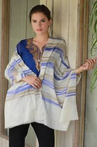"""Novica is National Geographic's fair trade website. There, you can purchase a one-of-a-kind, handmade, real cashmere pashima from the artisan who made it. This """"Purple Horizon"""" pashima was made by Karmabhoomi, a craftsman in India. If it's sold, don't worry, the website has a lot more!"""
