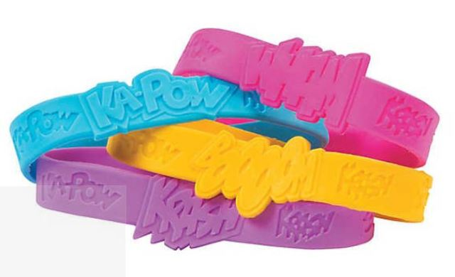 Rubber bracelets are perfect for Trick or Treating handouts. They are fun, safe, colorful, and kids adore them. These are also verifiably jewelry art. Superhero Girl Sayings Bracelets feature bold embossed and intaglio mottos taken from classic comic book graphics. The Design and fonts used are wonderful. orientaltrading.com.