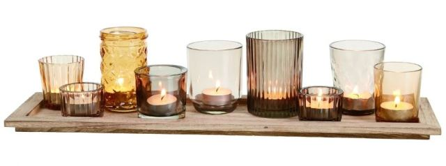 Instant collection. Glass Harvest Candle Holder includes 9 different tea light cups and a wood tray in the set. overstock.com