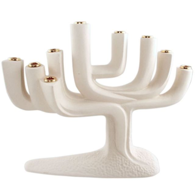 Porcelain Menorah. https://www.traditionsjewishgifts.com/menorah-hanukkah-contemporary-porcelain-quest-gift-QUMEN33A.html