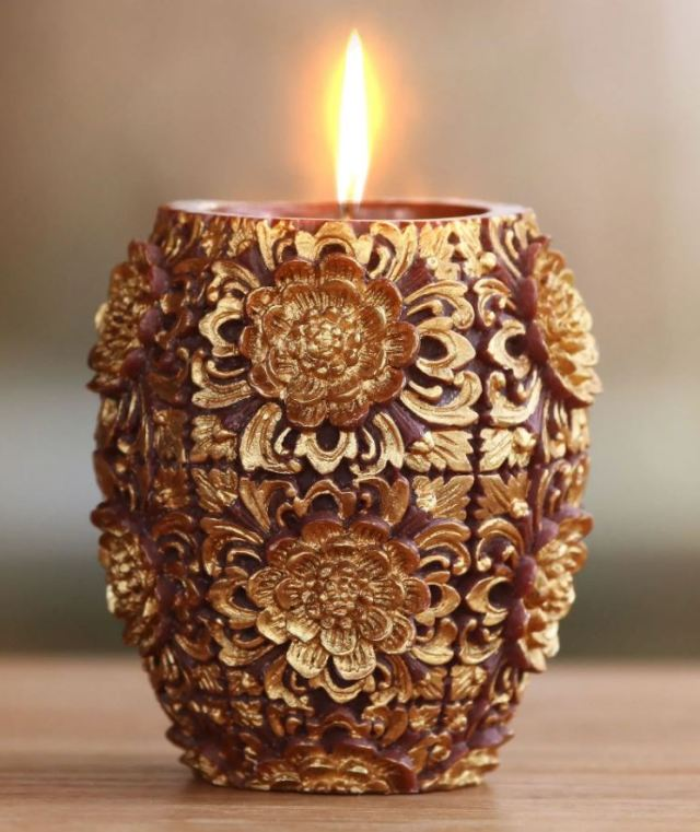 Satnam Sarna's candle in a vase shape. The Gold Colored Floral Vase Shaped Candle is also available at novica.com.