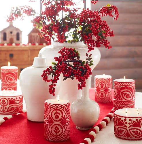 These cheerful candles are carved to reveal glowing white behind the bright red designs. And guess what? They are also available in gold! Nordic Rosemaling Candles. Wisteria.com