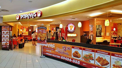 Popeyes Louisiana Kitchen chicken fast food restaurant at Century Square in Singapore.