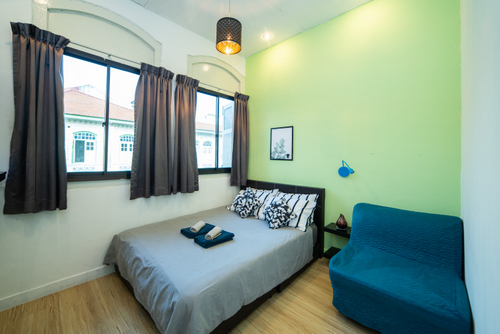 Guest room at Q Loft Hotel Geylang in Singapore.