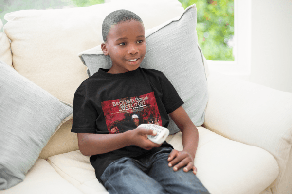 t shirt mockup of a kid watching tv on a couch 43919 r el2