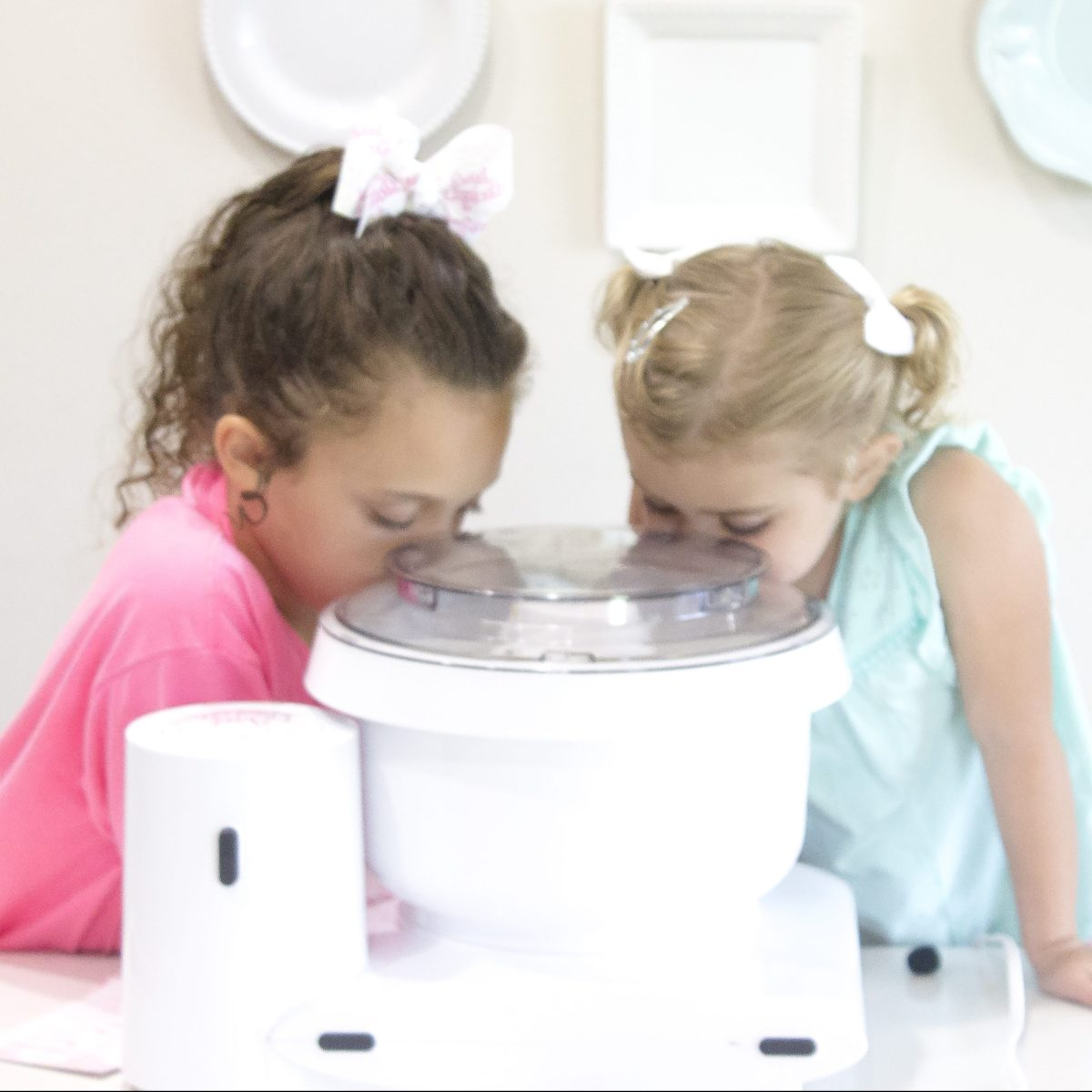 girls with mixer baking
