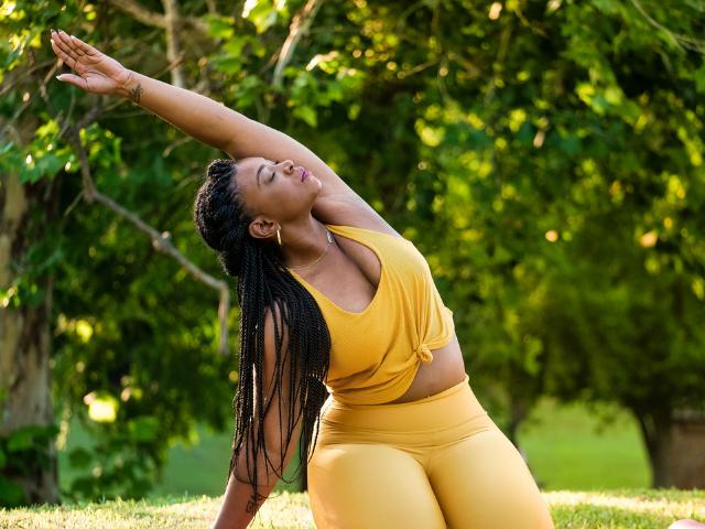 A black woman doing a yoga pose