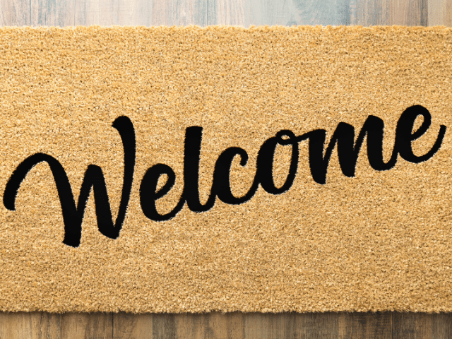 """welcome mat with the word """"welcome"""""""