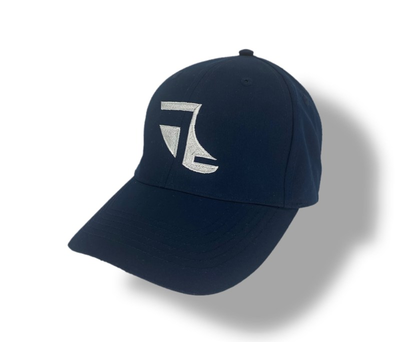 Angled image of Navy Blue ShoreTees Baseball Cap with White embroidered Fin Logo